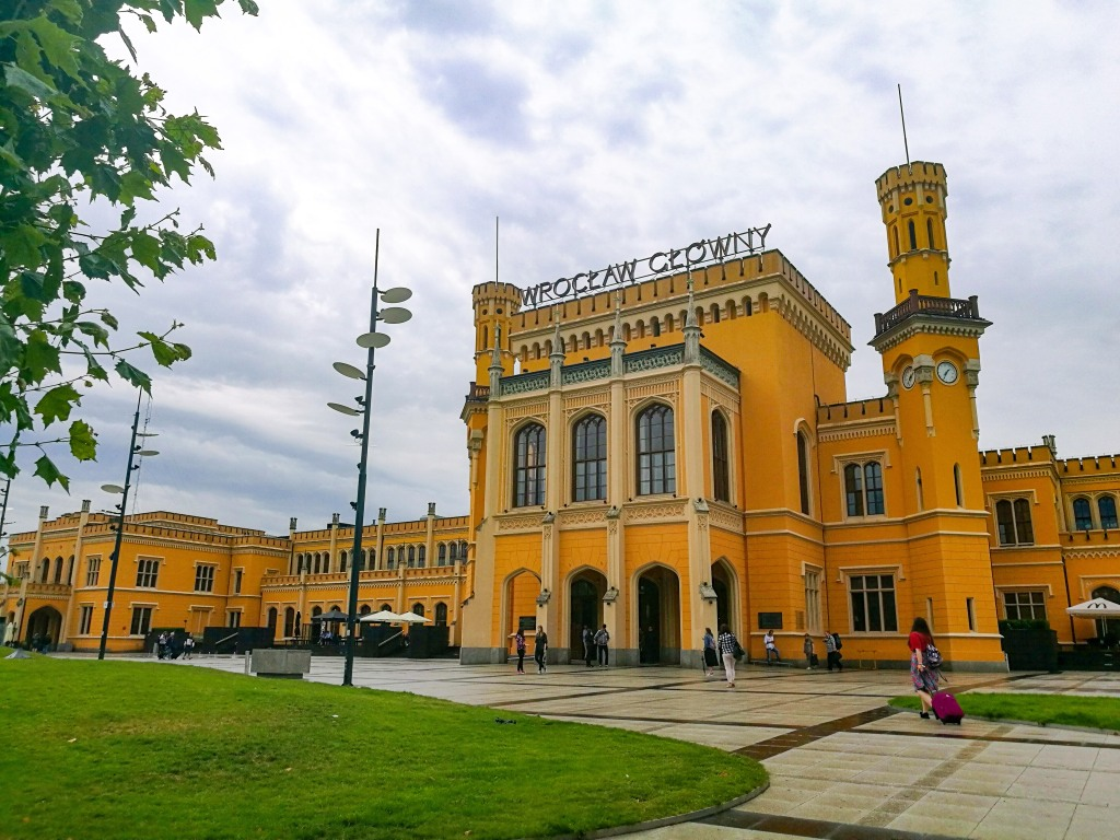 The bright yellow Wroclaw train station on a gloomy day