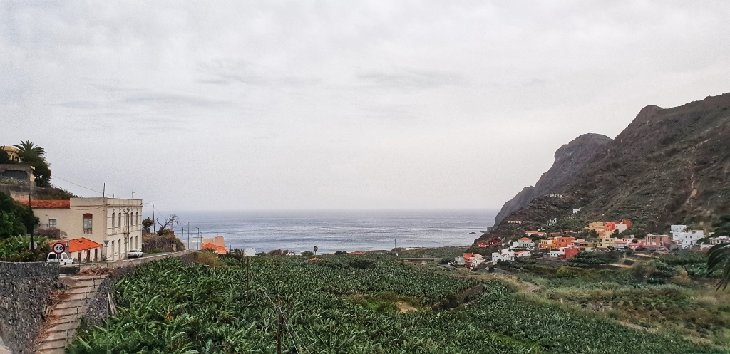 Hermigua valley with colourful houses on each side and banana fields in the middle
