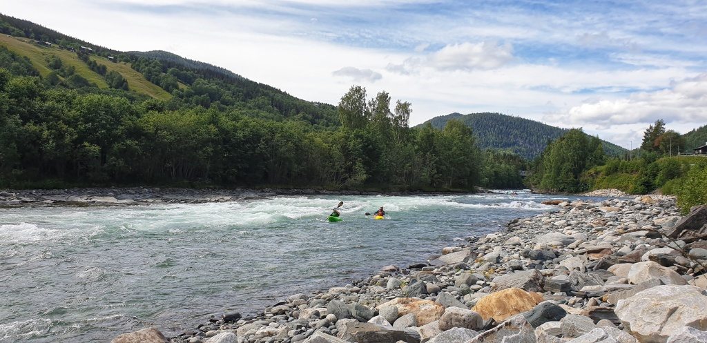 Two white water kayakers padling on Sjoa in Heidal during summer
