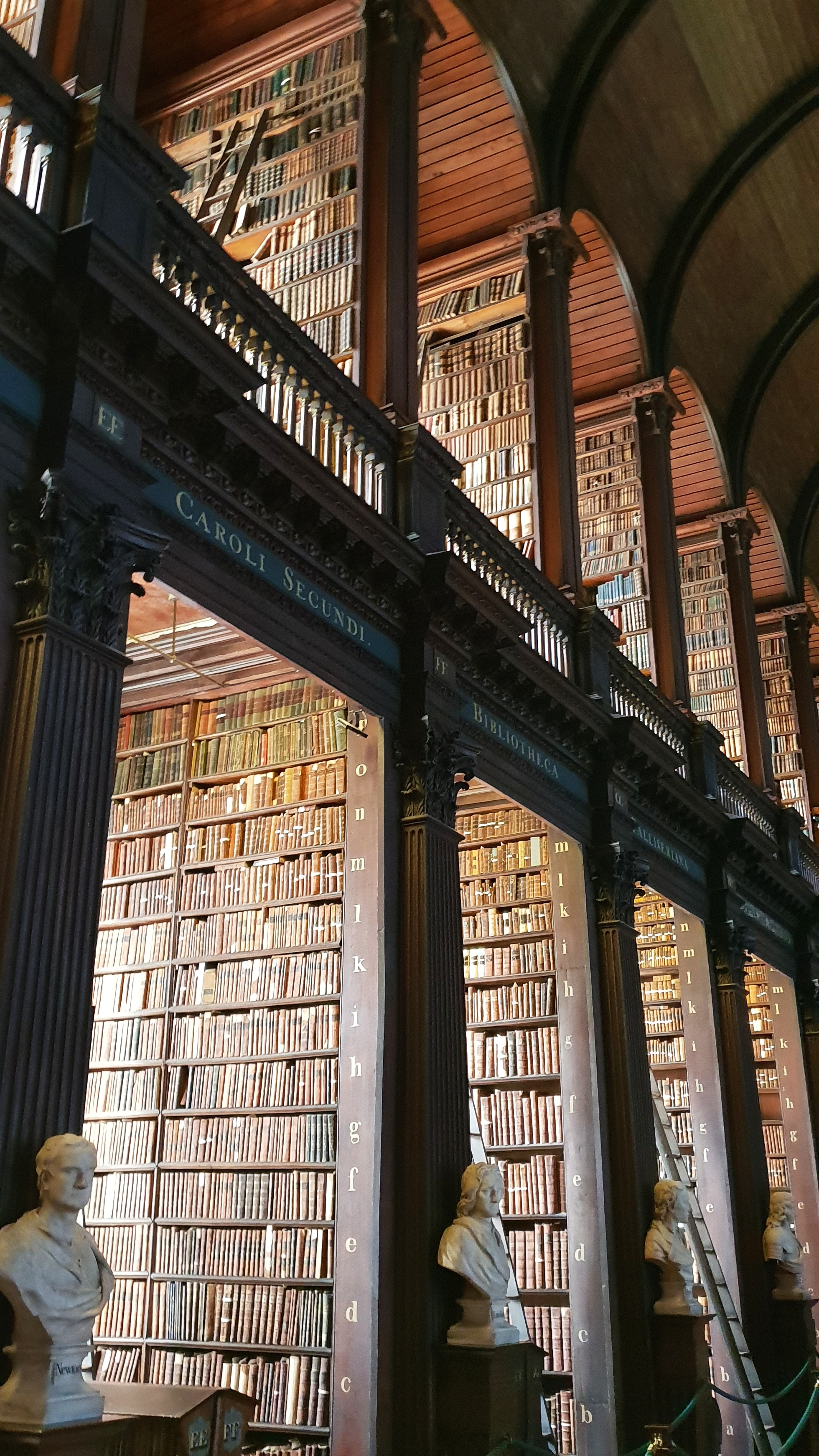 Two floors of old books at Trinity College Library