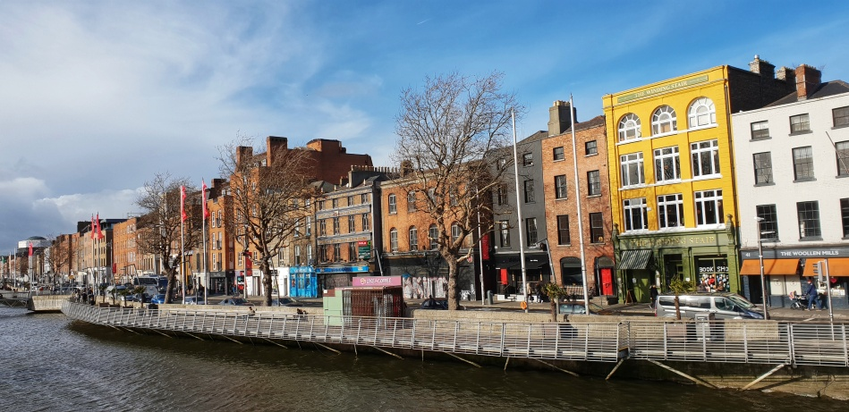 Street and brick buildings along the river Liffey in Dublin