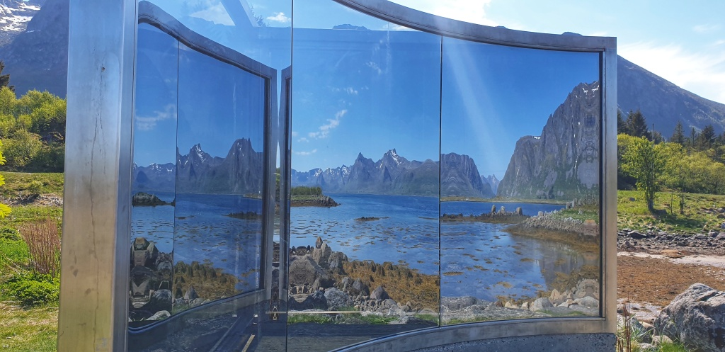 Mirrored view of mountains and sea in Lofoten in an art installation.
