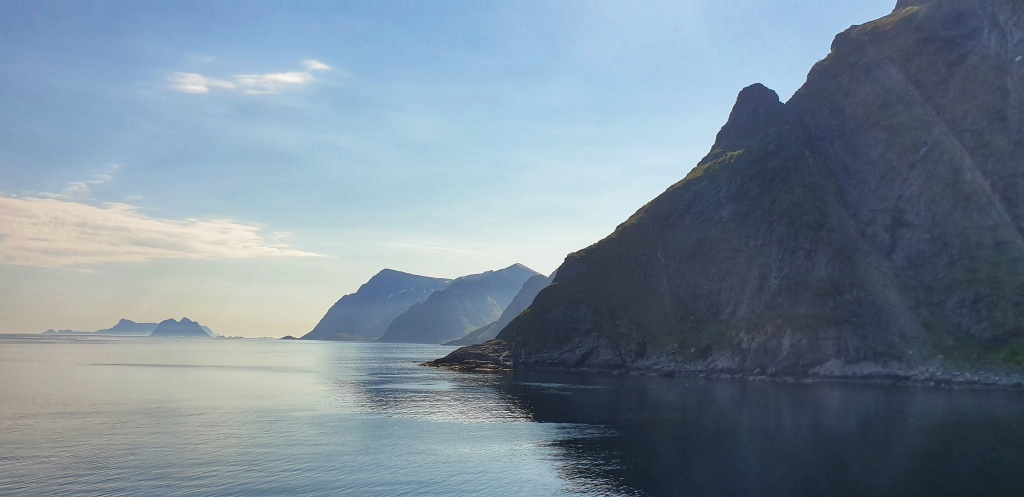 Mountains lining the sea seen from Å in Lofoten. Islands in the distance.