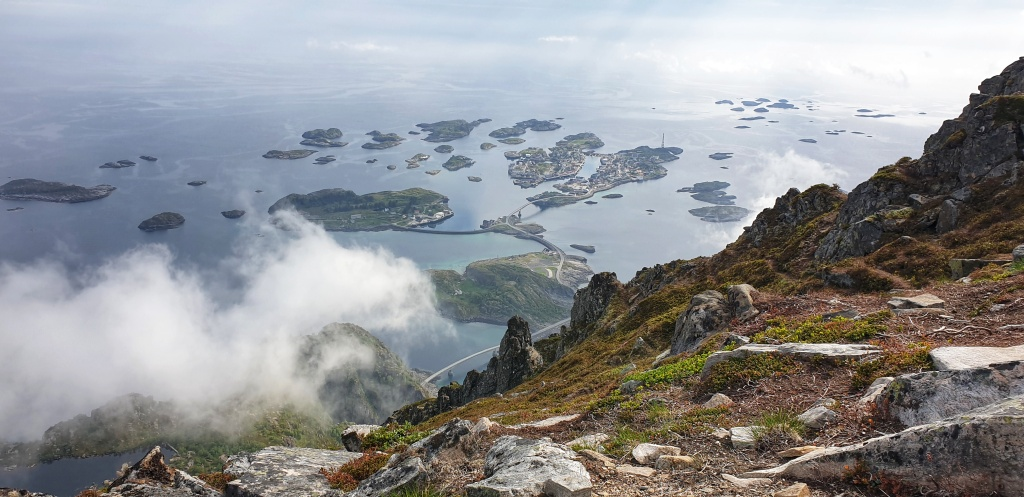View of Henningsvær, the horizon and clouds from festvågtind mountain.