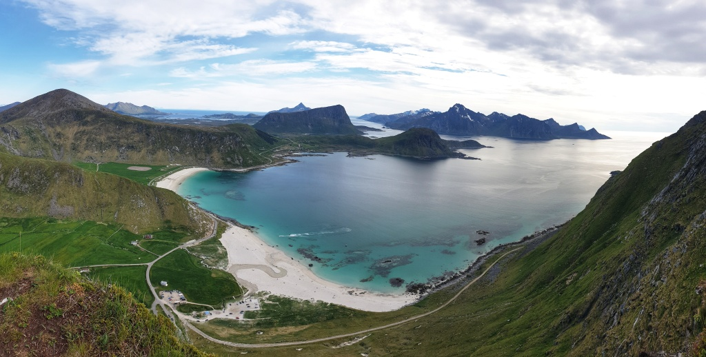 Vie to mountains, beaches and the sea from Mt. Mannen in Lofoten.